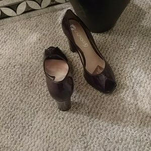 Patent leather peep toe shoes.